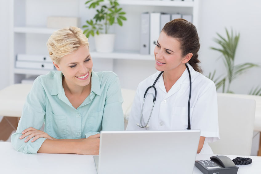 44793859 - patient and doctor looking at computer in medical office