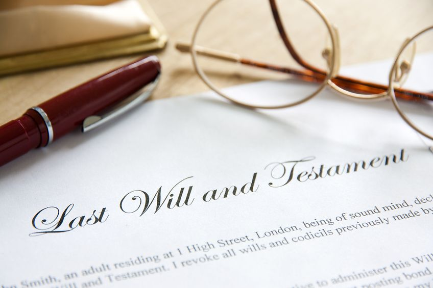 18954926 - last will and testament concept image complete with spectacles and pen.