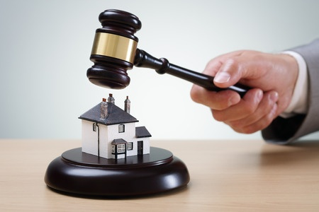 45840645 - bidding on a home, gavel and house concept for home ownership, buying, selling or foreclosure
