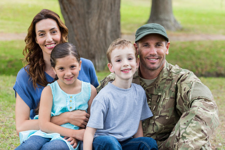 42671787 - handsome soldier reunited with family on a sunny day