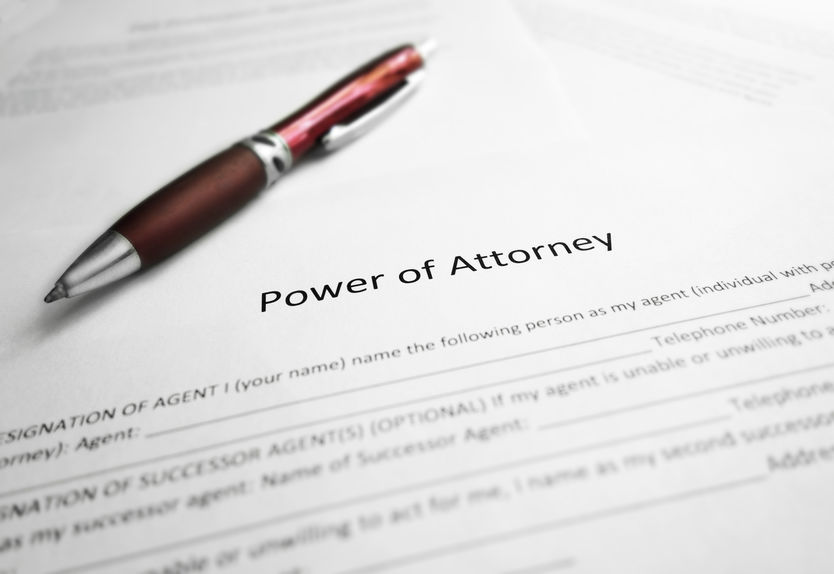 Power of Attorney legal document and pen